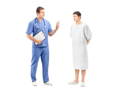 hospital gown: Full length portrait of a male patient in a hospital gown and medical practitioner during a discussion isolated on white background