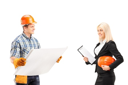 Male engineer holding a blueprint and discuss with female architect isolated on white background photo