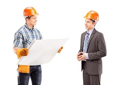 Male engineer holding a blueprint and having a conversation with architect isolated on white background Stock Photo - 18751097