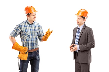 Male manual worker having a conversation with architect, isolated on white background Stock Photo - 18751113