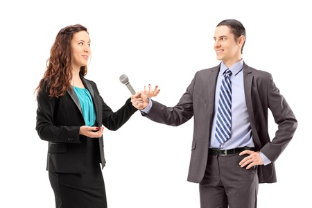 journalists: A businesswoman and male reporter having an interview, isolated on white background