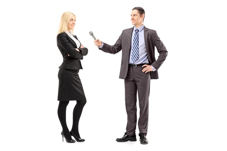 tv reporter: Full length portrait of a businesswoman and male reporter having an interview, isolated on white background