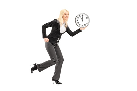 Full length portrait of a businesswoman running with clock isolated on white background  photo