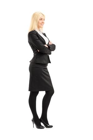 business woman standing: Full length portrait of a professional woman standing with arms crossed, isolated on white background