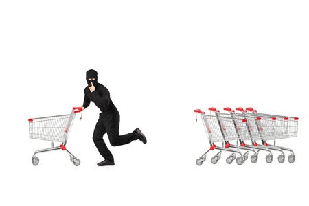 Full length portrait of a robber stealing an empty pushcart, isolated on white background  Stock Photo - 18751125