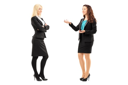 Full length portrait of a young professional women having a conversation isolated on white background photo