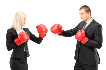 Young businesspeople with boxing gloves having a fight isolated against white background photo