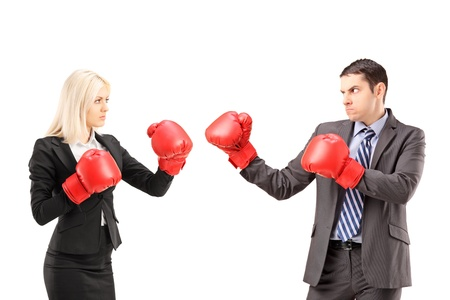 Young businesspeople with boxing gloves having a fight isolated on white background photo