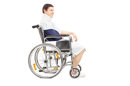 arm chairs: Disabled patient with broken arm in a wheelchair isolated on white background
