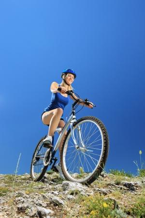 Female biker biking a mountain bike outdoor photo