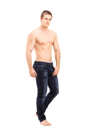 Full length portrait of a shirtless handsome man posing isolated against white background photo
