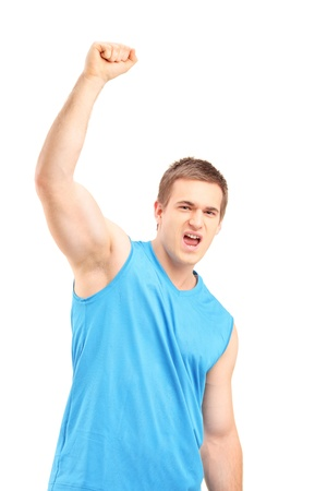 Young euphoric sportsman with raised hand gesturing happiness isolated on white background Stock Photo