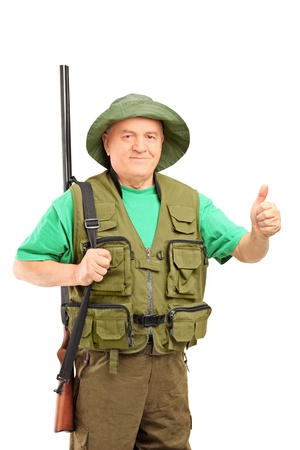 green thumb: A mature hunter holding a rifle and giving a thumb up isolated on white background Stock Photo