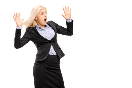 horrified: A young businesswoman gesturing fear isolated on white background Stock Photo