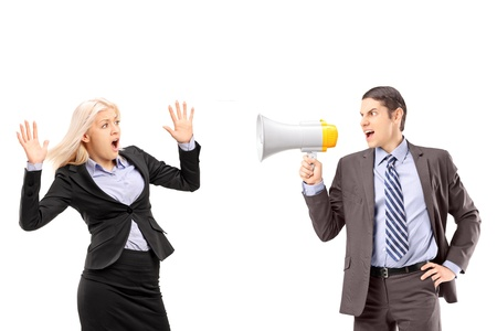 Afraid businesswoman and her manager shouting with a speakerphone isolated on white background Stock Photo - 18882044