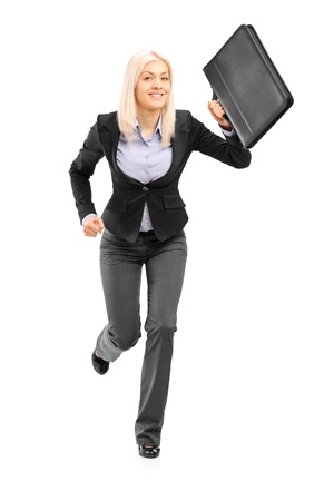 Full length portrait of a businesswoman running with a briefcase and looking at camera isolated on white background photo