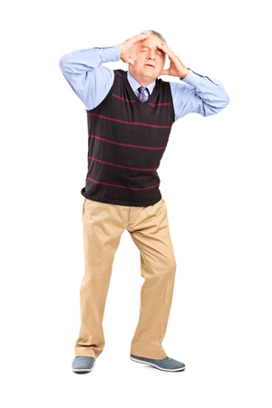 Full length portrait of a mature man holding his head in pain isolated on white background photo