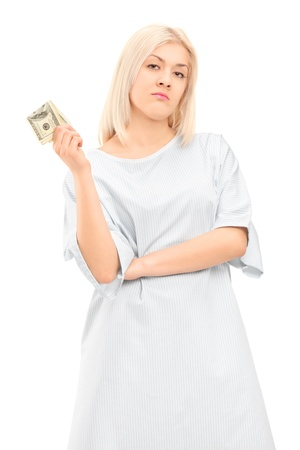 hospital gown: Female patient in a gown holding money, isolated on white background