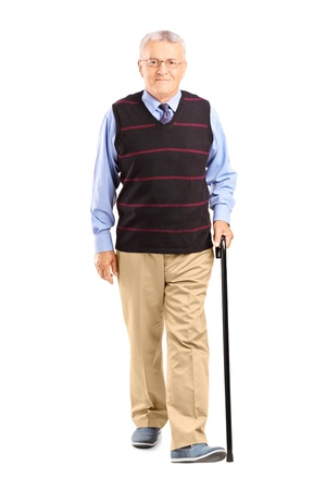 people walking white background: Full length portrait of a senior man walking with a cane, isolated on white background