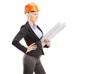 A female architect wearing an orange helmet and holding a blueprint isolated on white background photo