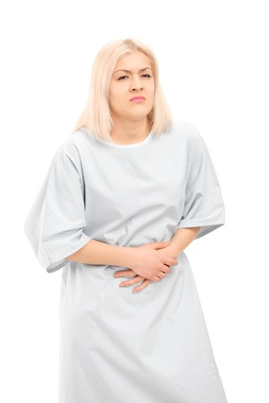 hospital gown: Female patient with a stomach ache, isolated on white background Stock Photo