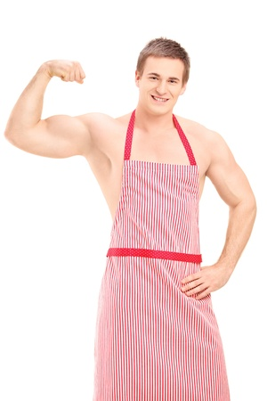 Sexy muscular man wearing a red apron, isolated on white background Stock Photo - 18909280