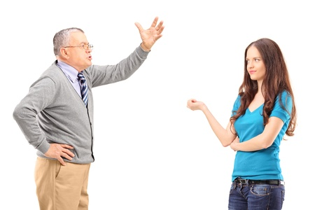 An angry father reprimanding his daughter isolated on white background photo