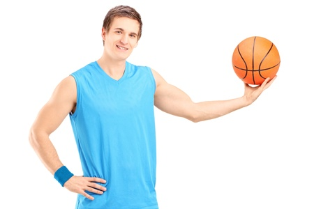 A basketball player posing isolated on white background photo