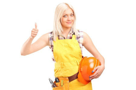 A female construction worker with equipment giving thumb up isolated on white background photo
