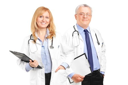 A team of doctors holding a clipboard and posing isolated on white background photo