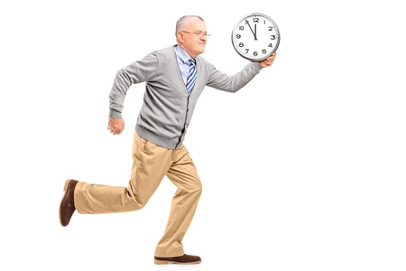 late 50s: Full length portrait of a mature gentleman running and holding a clock, isolated on white background