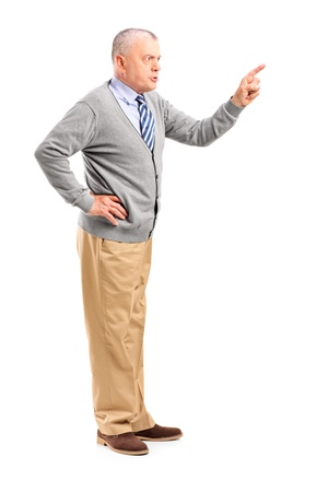annoyed: Full length portrait of an angry mature man pointing with finger and threatening isolated on white background