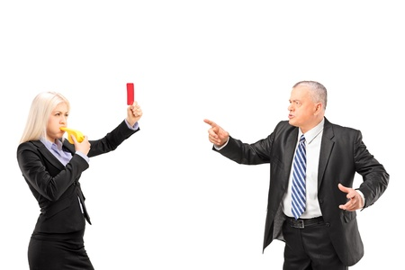 Professional woman showing a red card and blowing a whistle to her boss, isolated on white background photo