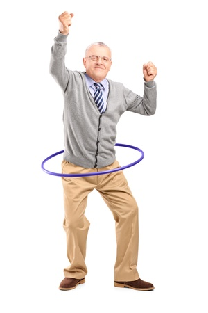 Full length portrait of a mature gentleman dancing with a hula hoop isolated on white background photo