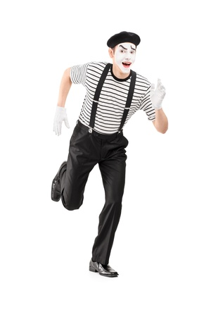 mimic: Full length portrait of a mime artist running and looking at camera, isolated on white background