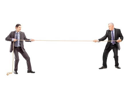 pulling rope: Full length portrait of two businessmen pulling a rope isolated on white background