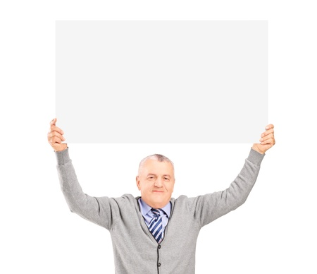 Mature gentleman sitting and holding a blank panel above his head isolated on white background photo