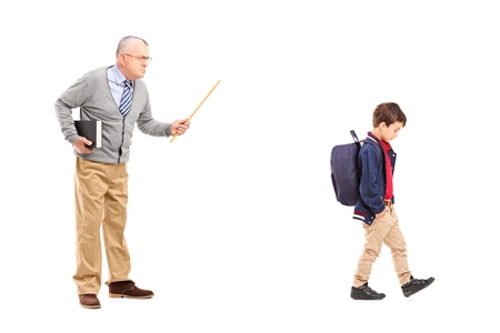 angry teacher: Full length portrait of an angry teacher shouting at a little schoolboy, isolated on white background Stock Photo