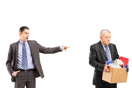 fired: Angry boss firing an employee, isolated on white background