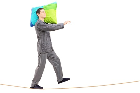 sleepwalker: Full length portrait of a man sleepwalking on a rope, isolated on white background Stock Photo