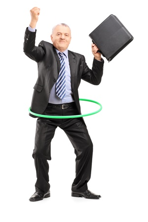 Full length portrait of a matue businessman dancing with a hula hoop, isolated on white background photo