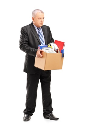 man carrying box: Full length portrait of a retired professional man with a box of belongings, isolated on white background Stock Photo
