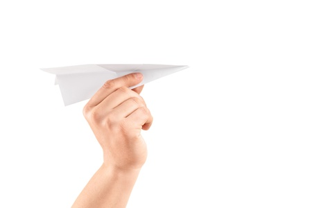 Male hand holding a paper airplane, isolated on white background photo