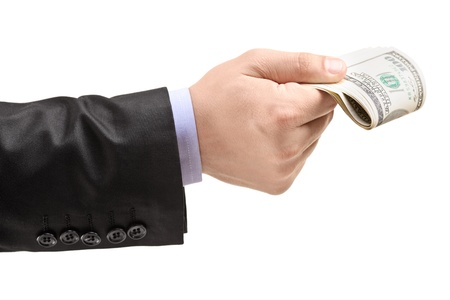 Male hand oferring money, isolated on white background Stock Photo - 19211807