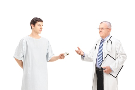 doctor giving dollars: Male patient offering bribe to a mature doctor, isolated on white background