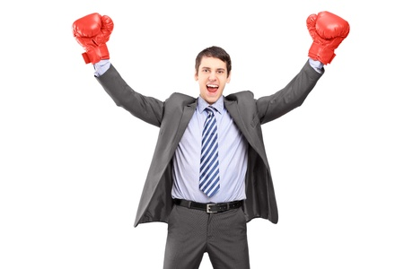 work glove: Young man in a suit and boxing gloves, celebrating a win, isolated on white background Stock Photo
