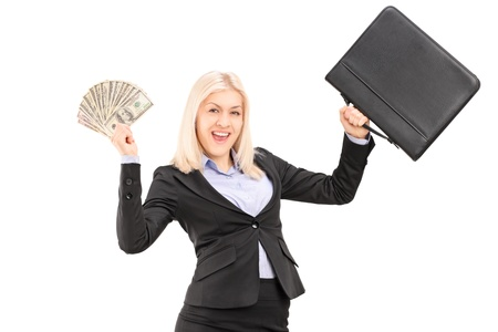 woman holding money: A happy businesswoman holding US dollars and briefcase isolated on white background Stock Photo