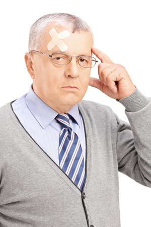Portrait of a mature gentleman with headache looking at camera isolated on white background photo