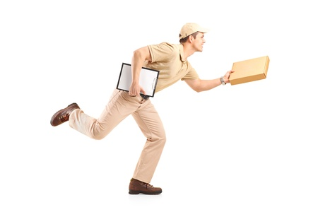 Full length portrait of a delivery boy in a rush delivering a package isolated against white background photo