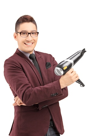 Smiling male hairdresser holding a blow dryer, isolated on white background photo
